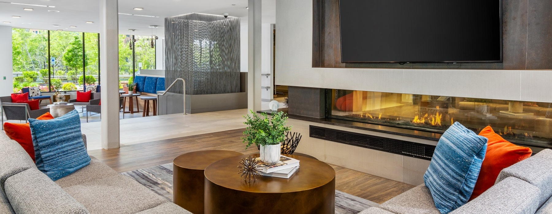Resident lounge area with fireplace, flatscreen TV and seating